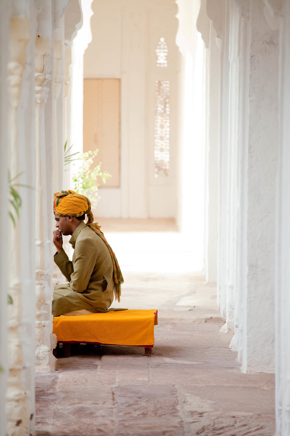 Idian-musician-thinking-yellow-white-turban-jodpur-fort-rajasthan-india-asia-travel