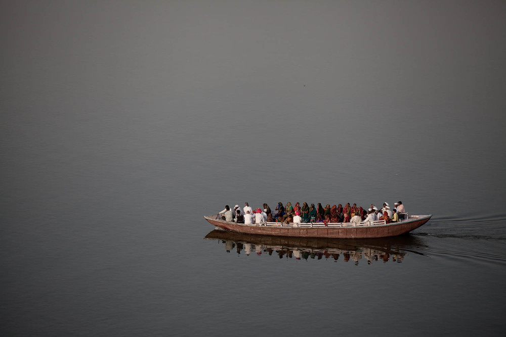 River-taxi-ganges-local-people-water-reflections-holy-varanassi-india-asia-travel
