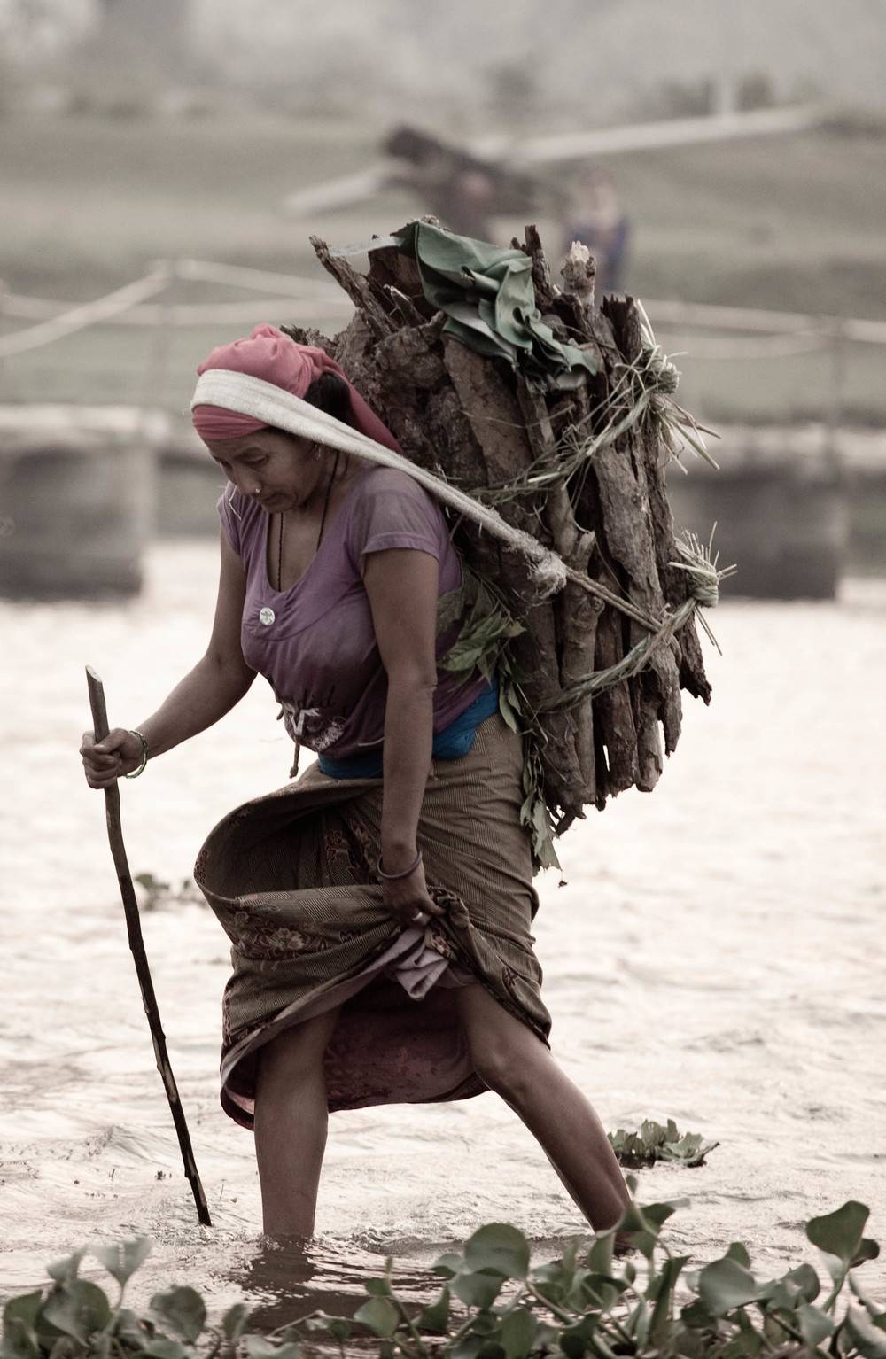 Portrait-woman-villager-wood-collection-river-crossing-chitwan-national-park-nepal-asia-travel