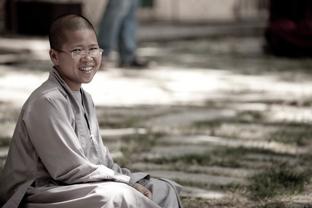 a Buddhist nun in the Dalai Lamas residence monastery in Dharamasala, India. Taking part in a debating session. When the monk has made their point they slap their hands together and wait for their opponents rebuttal.