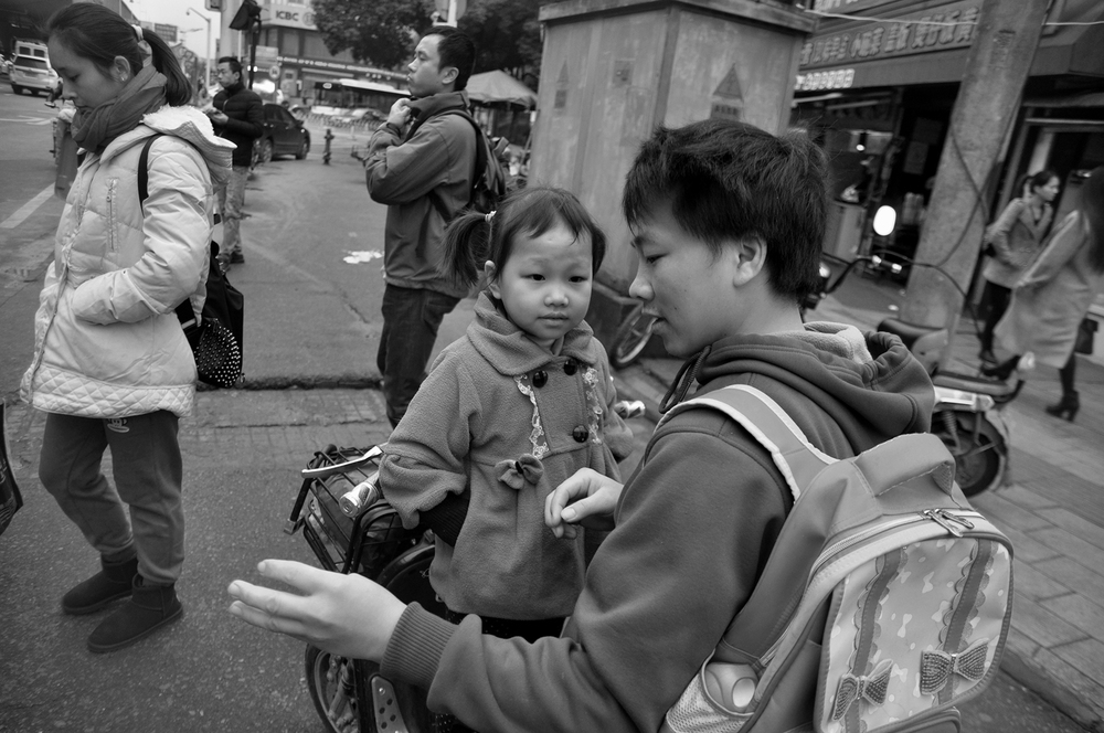 Father taking daughter to school, Wuhan