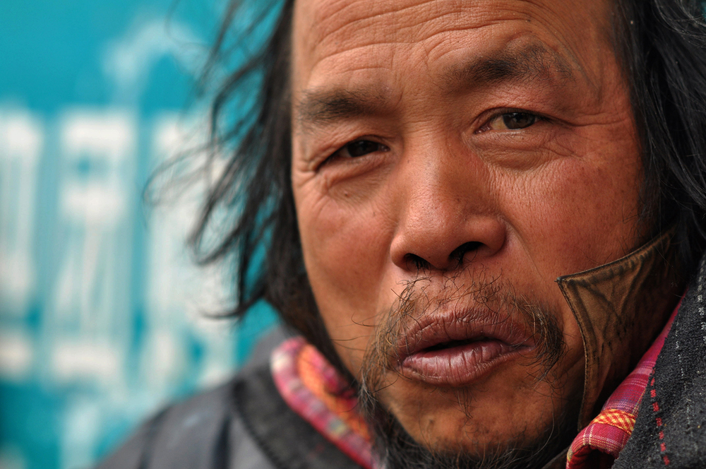 Homeless man, Han Zheng Street, Wuhan, 2015