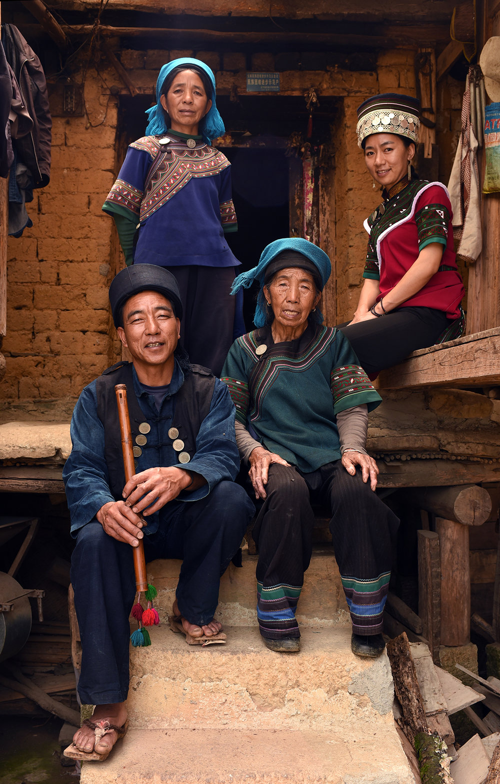 Chen XiNiang, inheritor of polyphonic singing intangible cultural heritage, at home with his family, Luomo village, Yunnan, 2017.