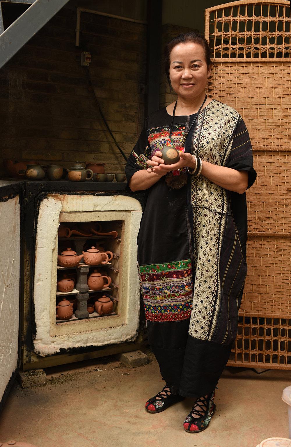 Li Fen Yu, Inheritor of Purple Pottery Intangible Cultural Heritage, Jianshui, Yunnan Province.