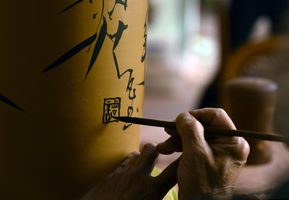 Tan Zhi Fan, Inheritor of Purple Pottery Intangible Cultural Heritage, Jianshui, Yunnan Province.