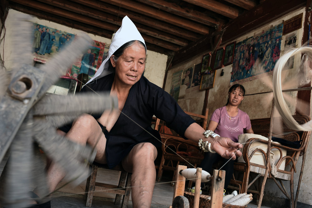 Mao LeBeng, master costume maker, Dayangjie town, Yunnan, 2017.