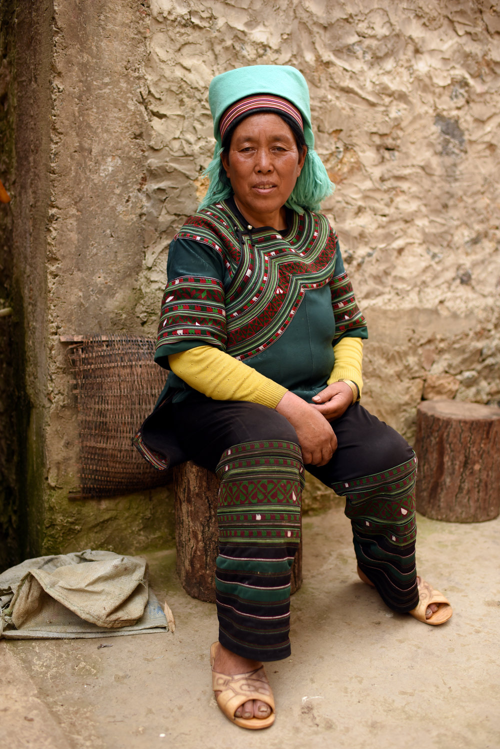 Wife of Inheritor Che Kasan ,  at home in   Qielong village, Yunnan, 2017.