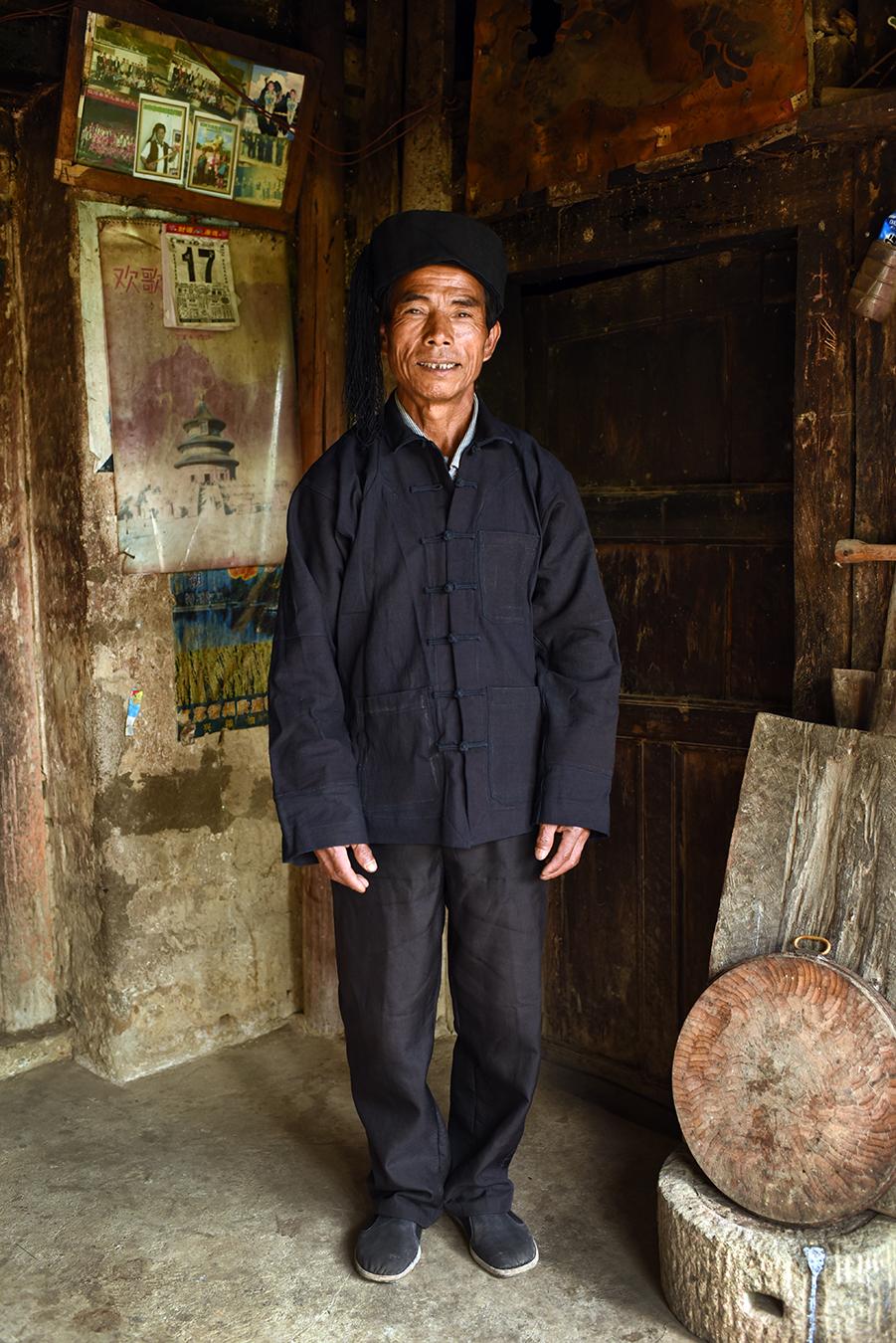 Hani man, a member of polyphonic singing intangible cultural heritage, Puchun village, Yunnan, 2017.