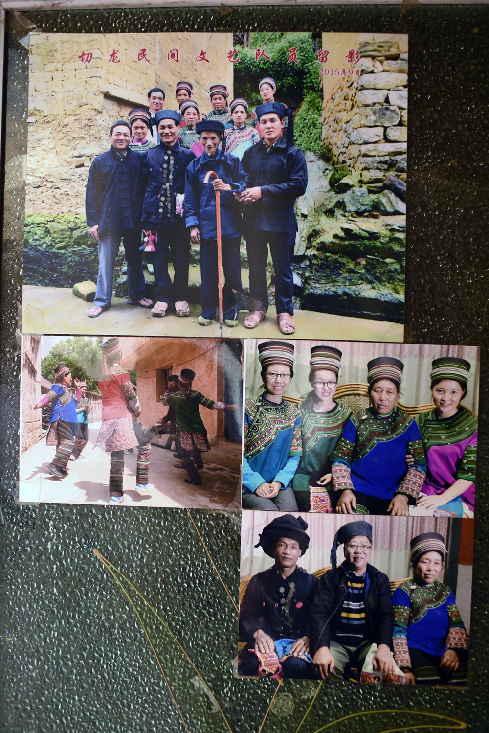 Photographs on the doorway of home of Che Kasan reveal long family history of involvement with musical intangible cultural heritage.   Qielong village, Yunnan, 2017.