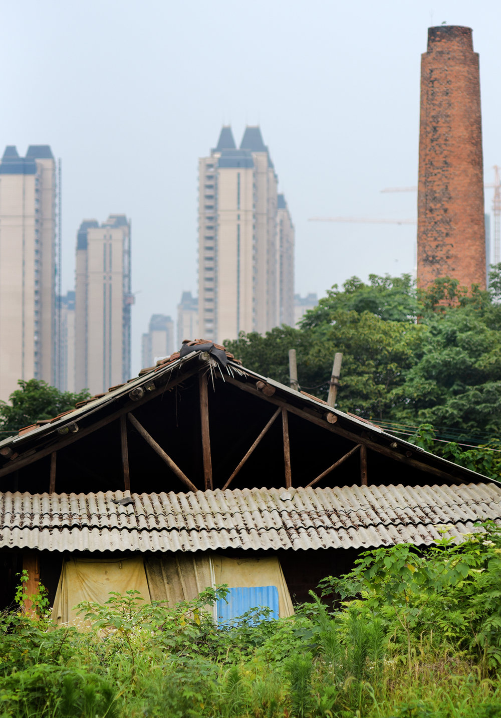 Against the backdrop of JIngzhou city, the workshop and kiln of Xia Yugu, Inheritor of ICH pottery.