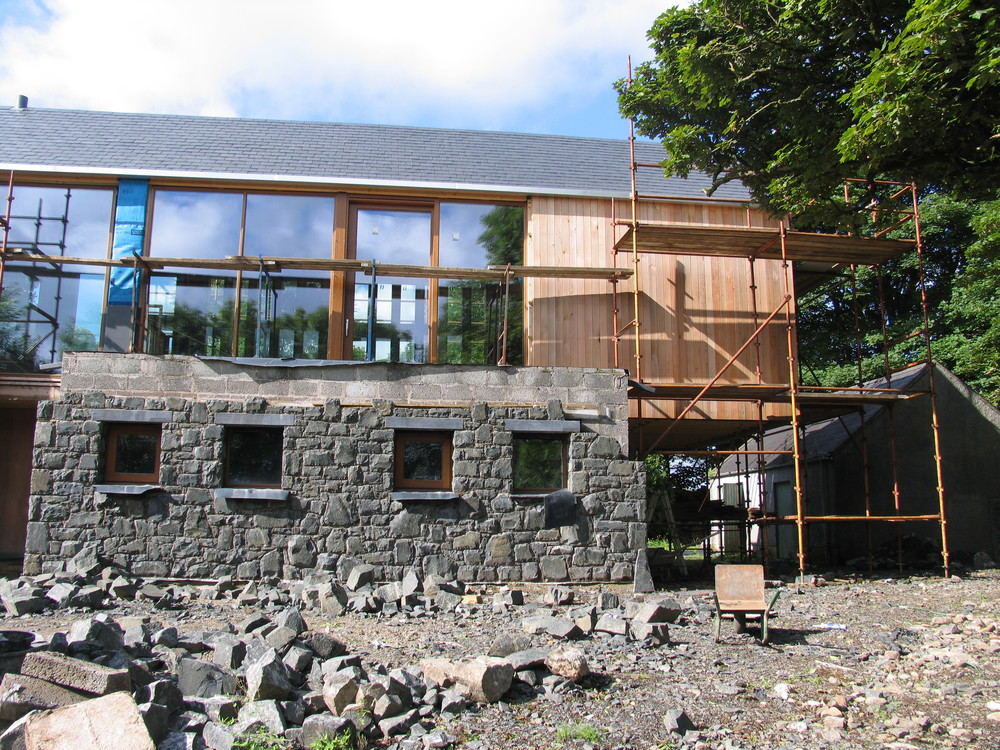 stone, windows, cedar cladding and cantilever