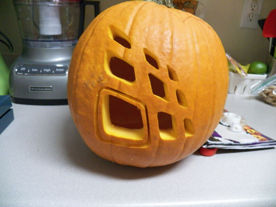 Industrial Designer carves a pumpkin