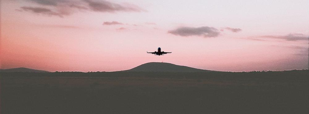 Airplane Takeoff Sunset