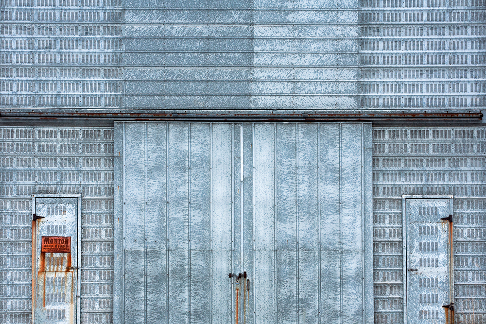 The side of an old metal corn crib somewhere outside of Mount Horeb, Wisconsin.  → License Photo