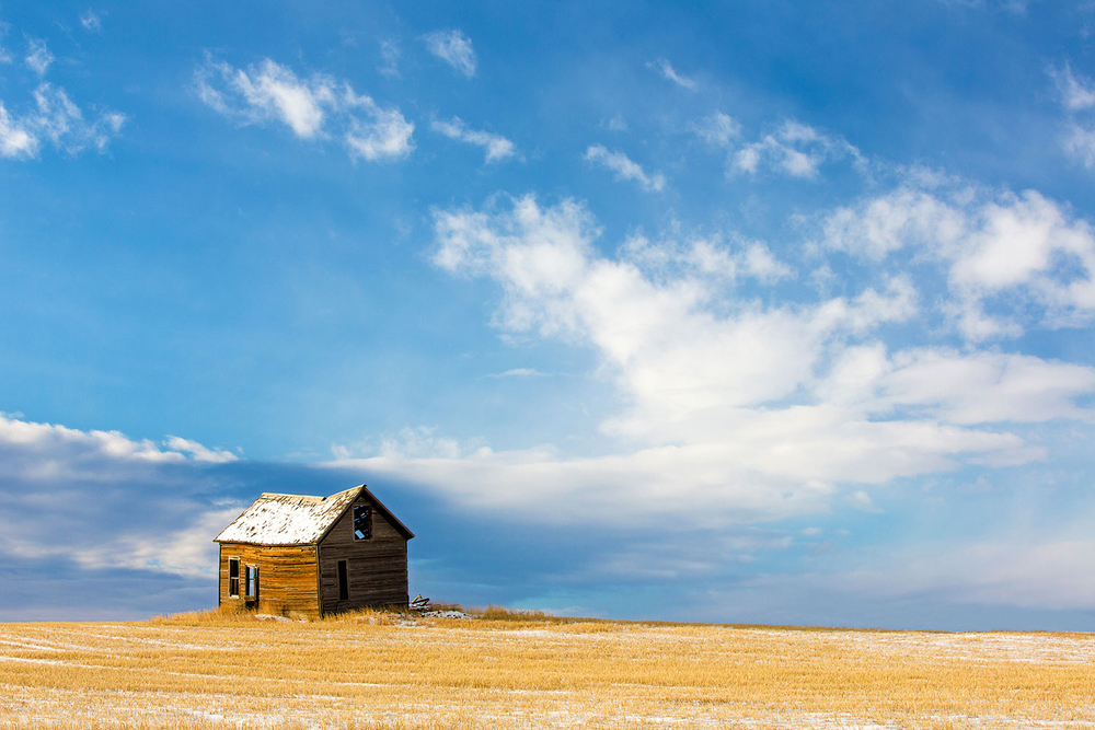 An old abandoned house surrounded by wheat stubble and snow south of Lake Elwell in Montana.   → Buy This Print