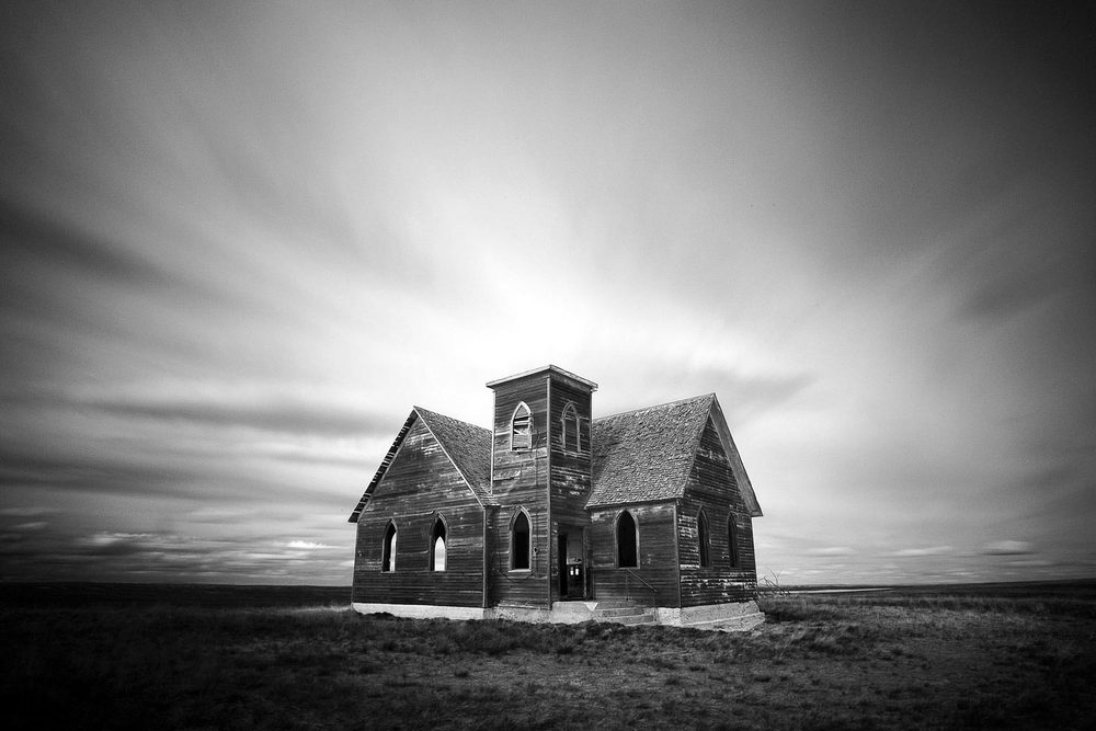 An old, abandoned church in the middle of the sprawling plains north and west of Kremlin, Montana. Formerly known as the Milk River Valley Church. → Buy a Print