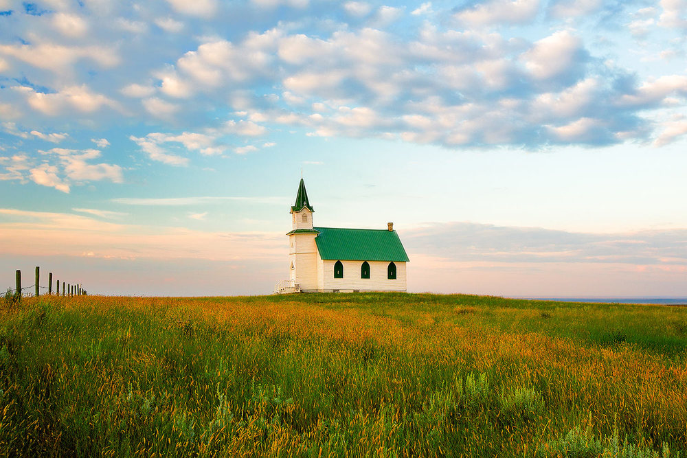 Things I like about Montana:  Lonely churches and schools surrounded by nothing but Montana's plains. → Buy a Print