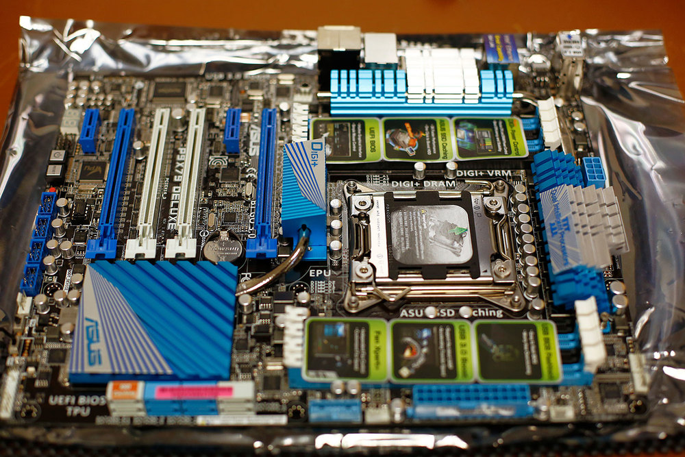 My new Asus P9X79 Deluxe motherboard sitting on the anti-static wrapper after unpackaging it.