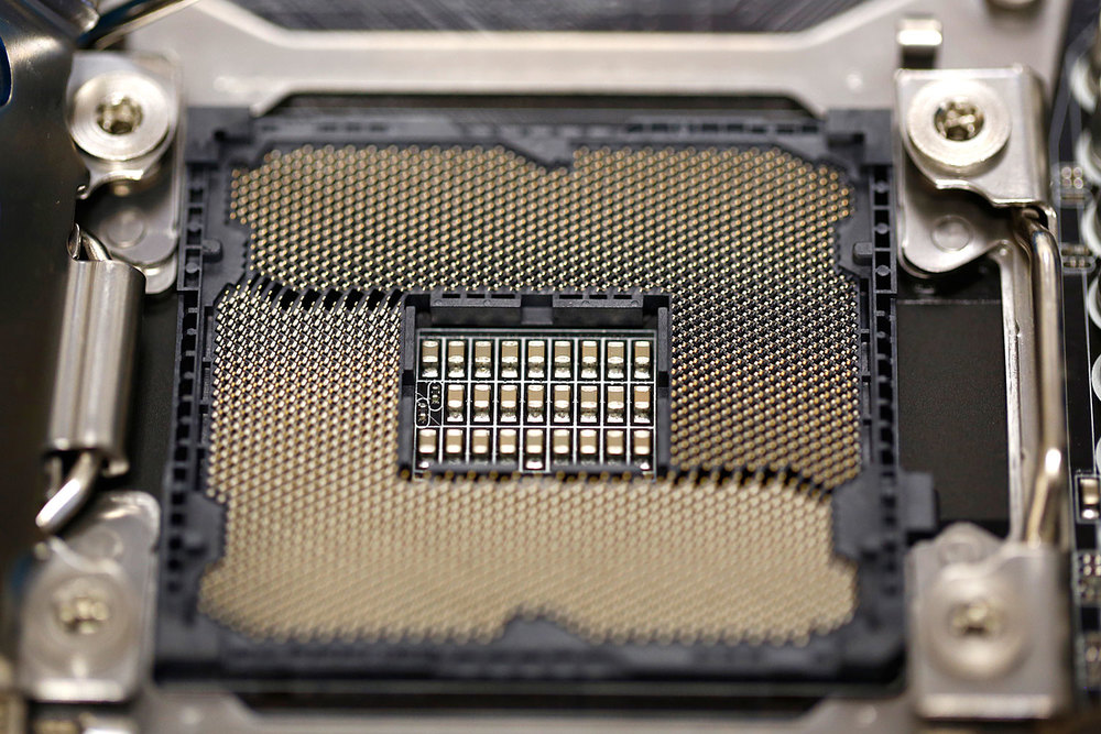 A close-up of all the many pins and connection points on the microprocessor socket.