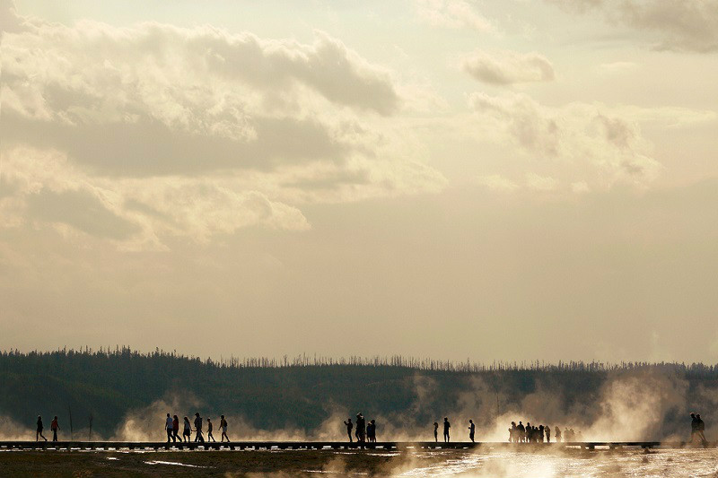 Tourists on the boardwalk at Grand Prismatic Spring in Yellowstone National Park. → License Photo