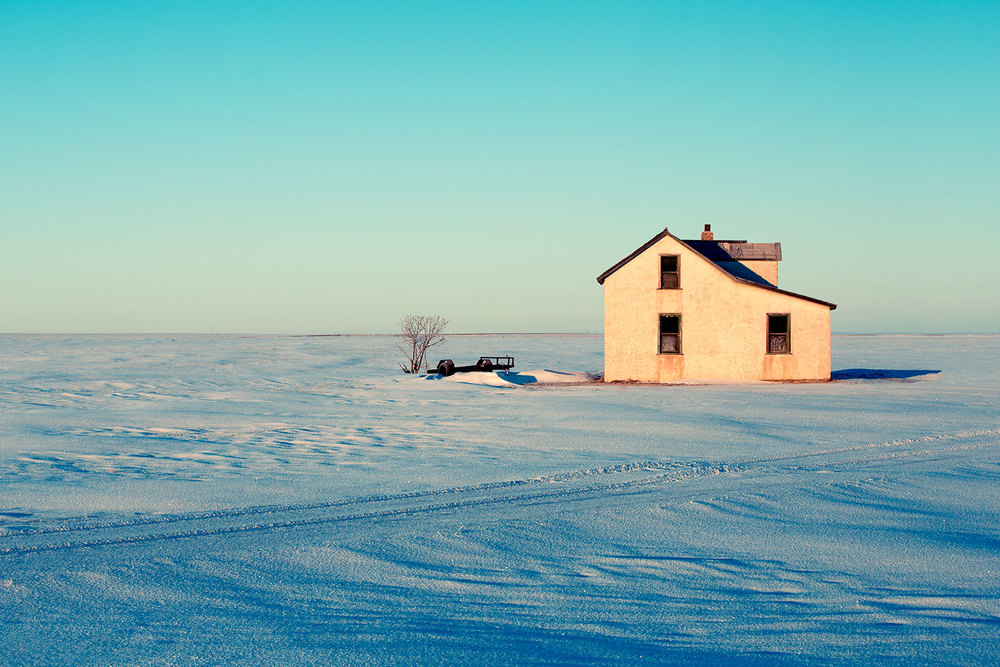 An old abandoned farm house surrounded by Montana's plains and snow north of Havre.   → Buy a Print