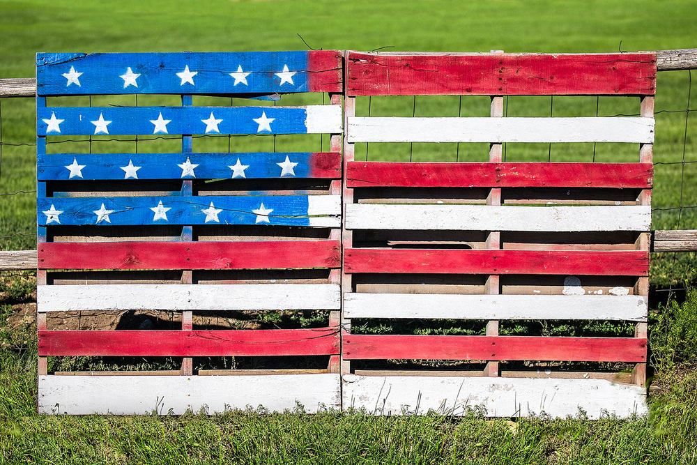 Wooden pallets repurposed and painted with the American flag celebrate the American spirit near White Sulphur Springs, Montana.   → Buy a Print