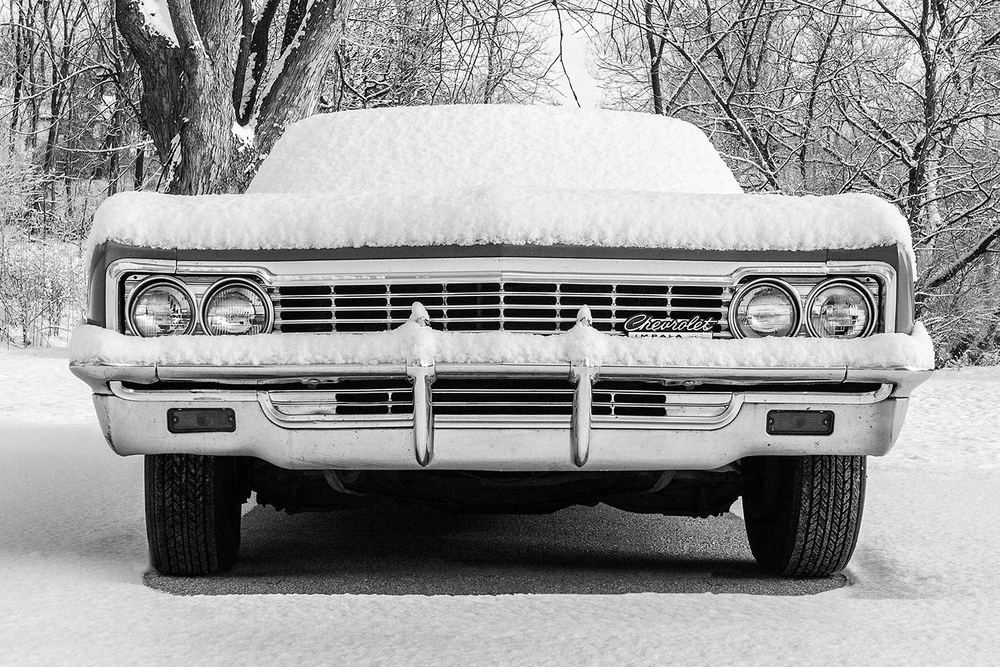 A snow covered 1966 Chevrolet Impala in Blanchardville, Wisconsin.   → Buy a Print