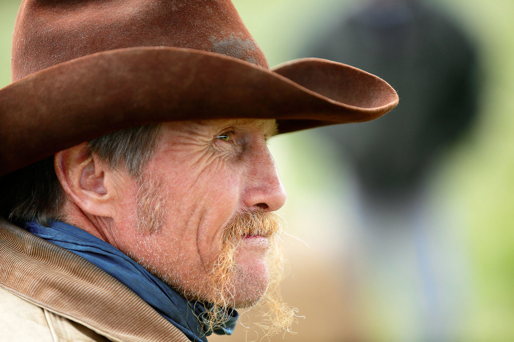 A candid profile shot of an old cowboy on a ranch near Lloyd, Montana. → License Photo