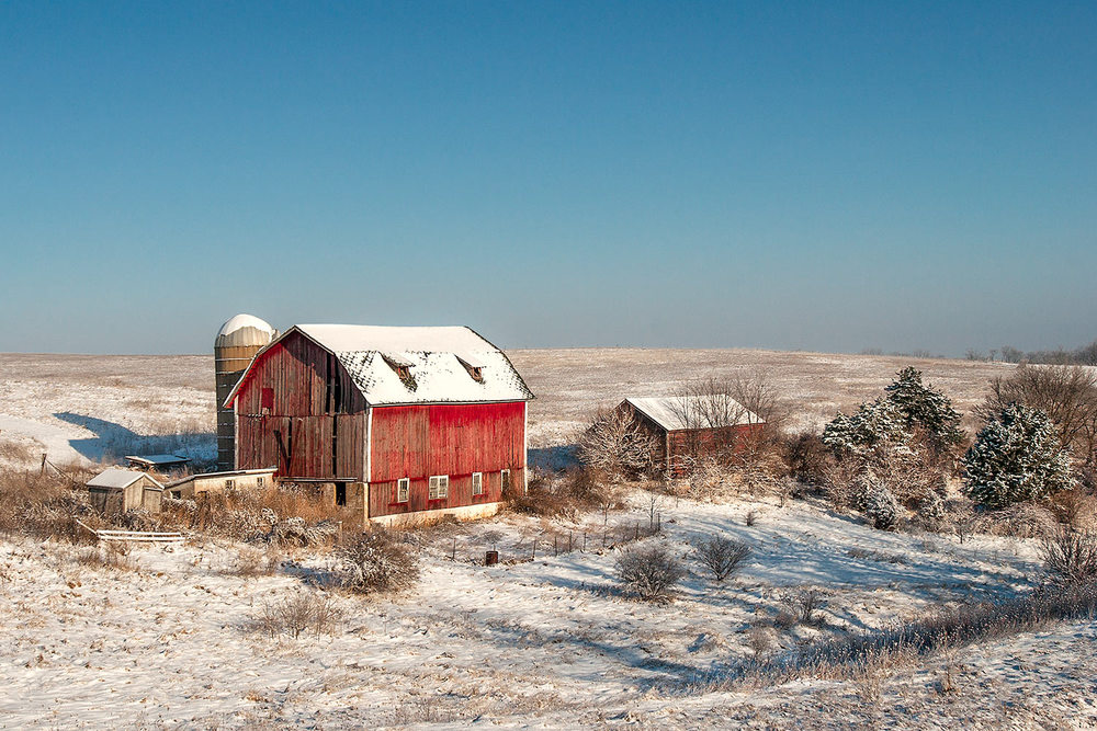 An old dairy farm no longer in use shrouded in snow near Blanchardville, Wisconsin.   → Buy a Print
