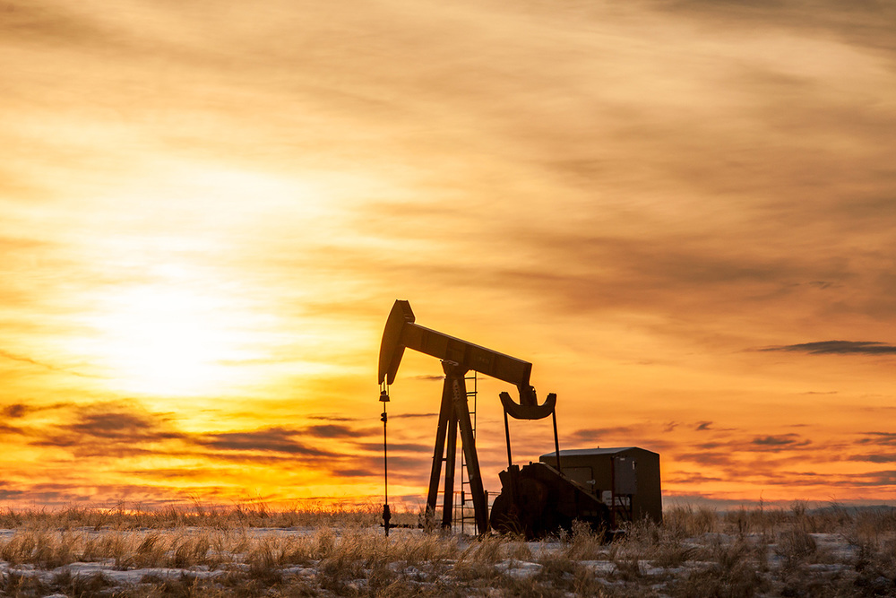 An oil pumpjack pumping petroleum against a brilliant sky south of Chinook, Montana.   → Buy a Print