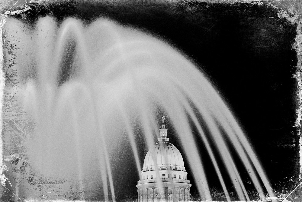An old fashioned photo of the Wisconsin State Capitol in Madison, Wisconsin with a rough, stained look.→ Buy a Print