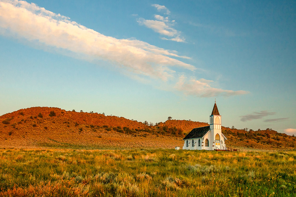 An old rustic rural country church illuminated by the morning light in Lennep, Montana.   → Buy a Print