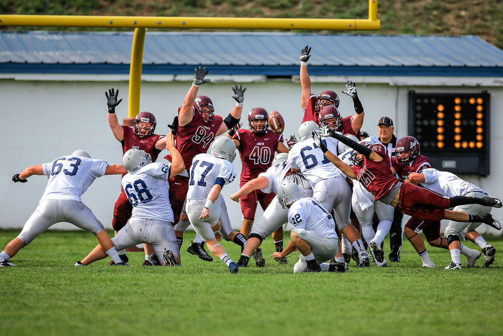 Photograph of a kicker attempting a field goal at MSU-Northern collegiate football game in Havre, Montana.