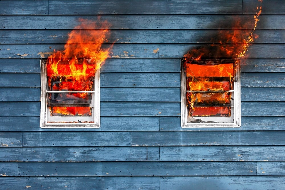 Flames leap from a burning house outside of Belleville, Wisconsin.   → Buy a Print