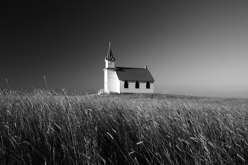 A beautiful rural church sits all alone on Montana's prairie south of Malta.   → Buy a Print     or   License Photo