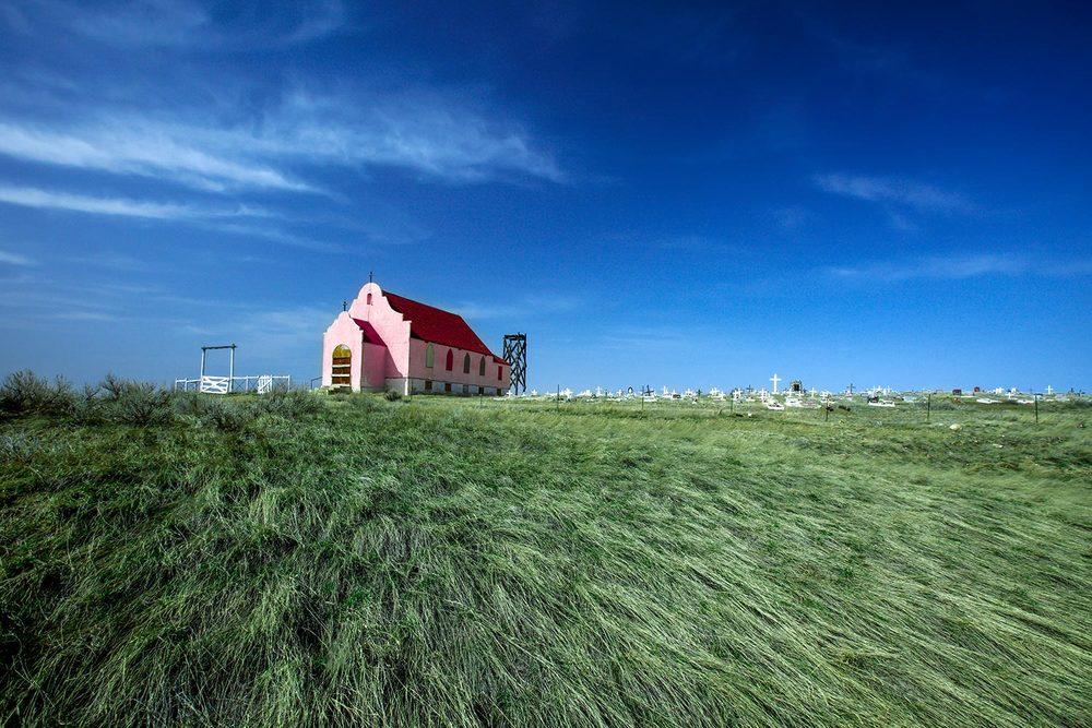 The Sacred Heart Catholic Church, locally known as The Pink Church, located outside of Harlem, Montana.   → Buy a Print     or     License Photo