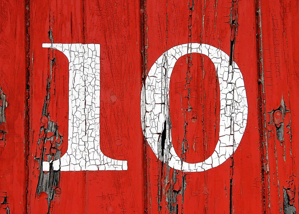 Chipping and peeling painted number 10 on the side of an old railroad car. → Buy a Print
