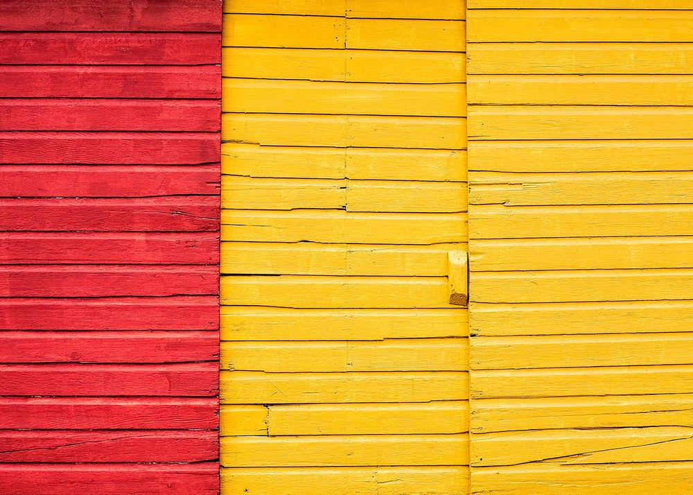 Rich, colorful sliding doors on the side of the New Glarus Lumber building in New Glarus, Wisconsin.   → Buy a Print