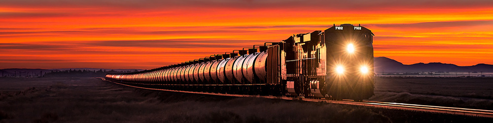 A BNSF train hauls oil from the Bakken oil fields to the west coast to be refined.   → Buy a Print