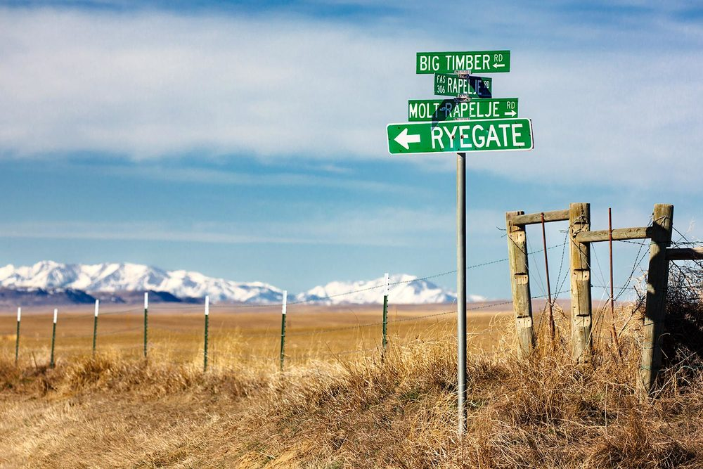 A rural sign post outside of rural Rapelje, Montana.     → Buy a Print
