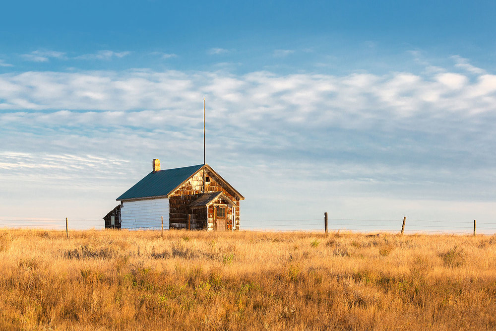 The old abandoned East Matla Colony schoolhouse located east of Malta, Montana. → Buy a Print or License Photo