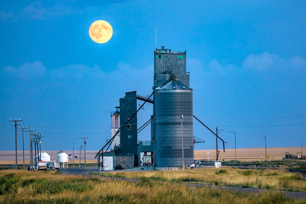 Farmers work late unloading barley at a grain elevator in Valier, Montana.