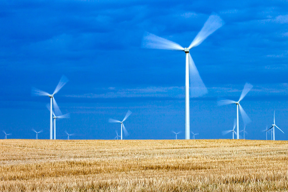 A time lapse photo of wind turbines in a field near Ethridge, Montana.→ Buy a Printor License Photo