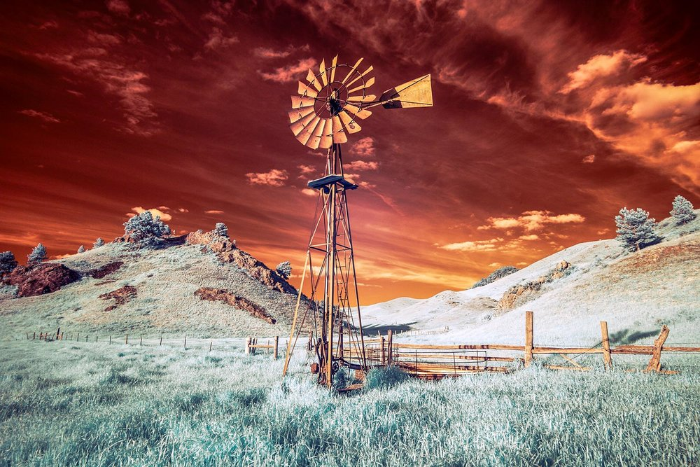 An infrared photo of a beautiful old windmill (a.k.a. windpump) on a ranch in the Bear Paw Mountains near Havre, Montana.   → Buy a Print   or   License Photo