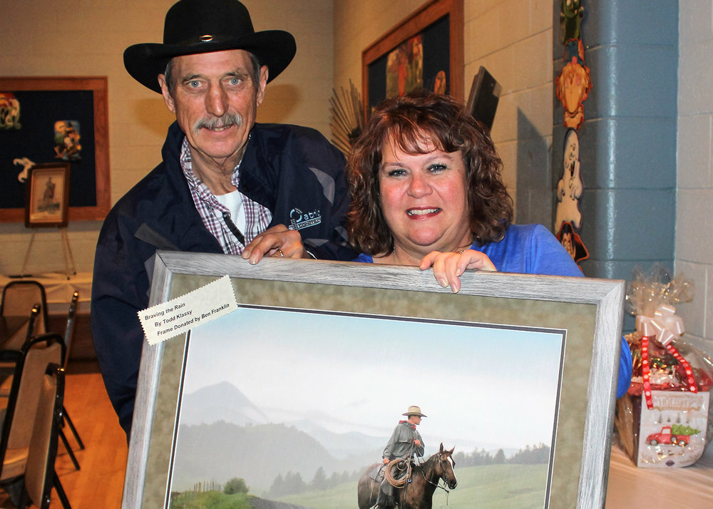"Sandra Friede, of Havre, Montana, was the winning bidder for my 16 x 24 print of my photo ""Braving the Rain"" at the charity auction to raise funds for Randy Terry's medical expenses."