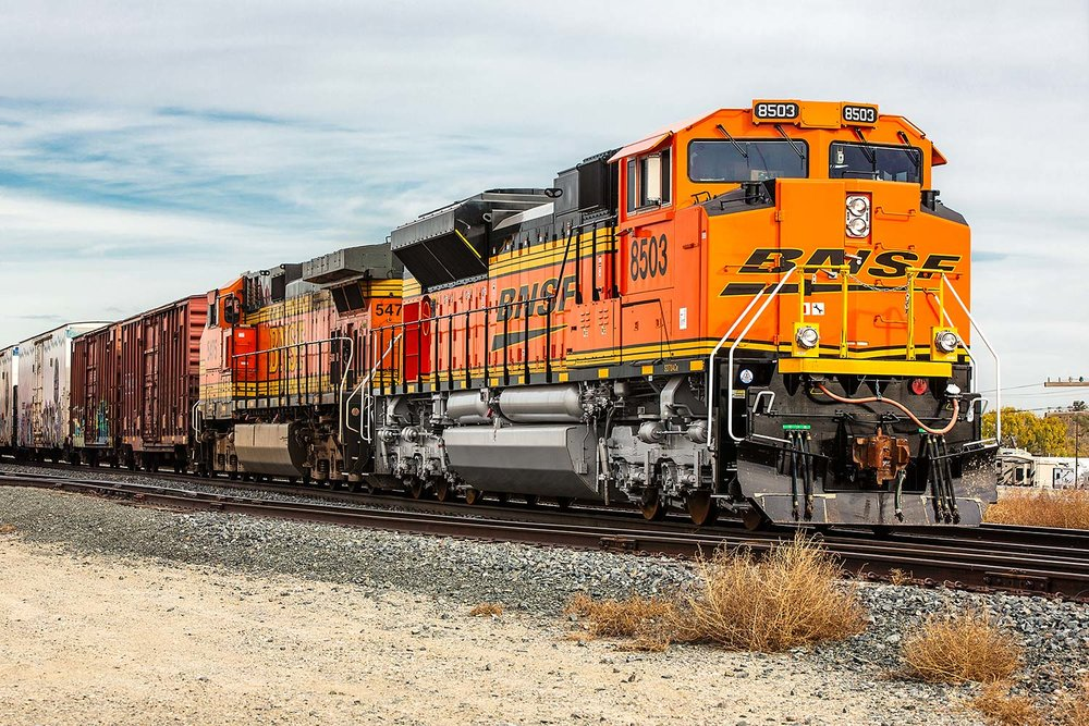 A BNSF Railways locomotive chugs on through the industrial district in Billings, Montana.