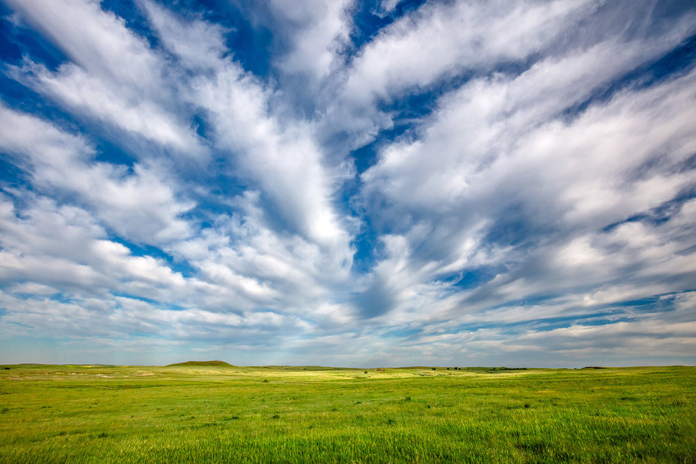 Streams of clouds race overhead near Baker, Montana.   → Buy a Print   or   License Photo
