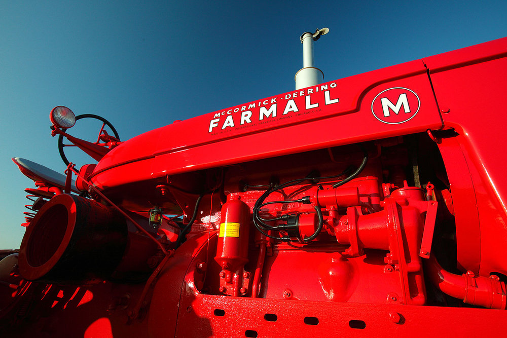 A bright red Farmall M tractor in Madison, Wisconsin.   → License Photo