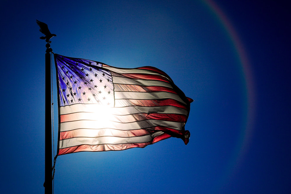 Photos-Sun-Shining-Through-American-Flag.jpg