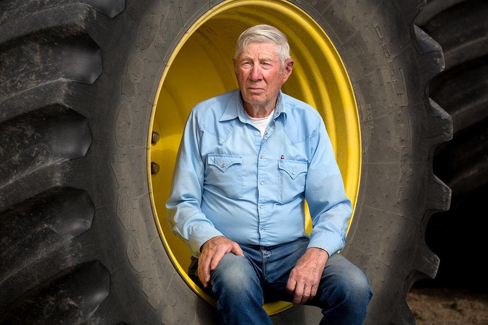 Farmer Sitting in Wheel
